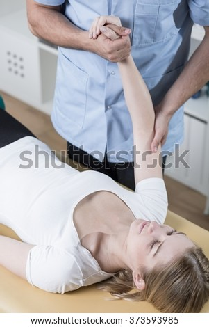 Young woman undergoing rehabilitation of injured arm