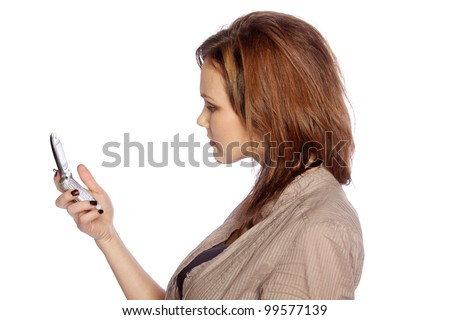 Young woman unhappy at something she sees on her cell phone - stock photo