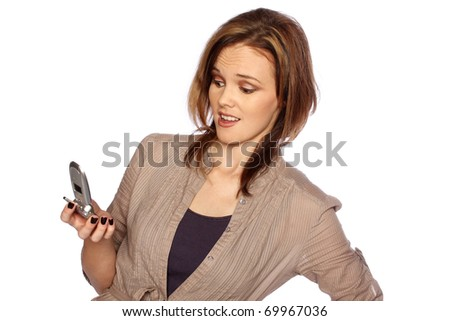 Young woman unhappy with something she sees on her cell phone