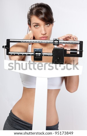 young woman unhappy with weight - stock photo