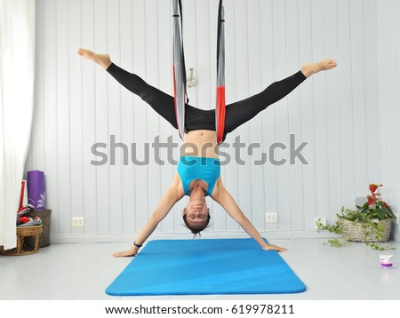 young woman upside down doing anti gravity aerial yoga in hammock on a seamless young woman upside down doing antigravity stock photo 619978211      rh   shutterstock