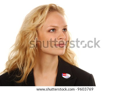 Young woman US voter with ID sticker. - stock photo