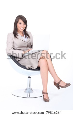 Young woman using a laptop computer - stock photo