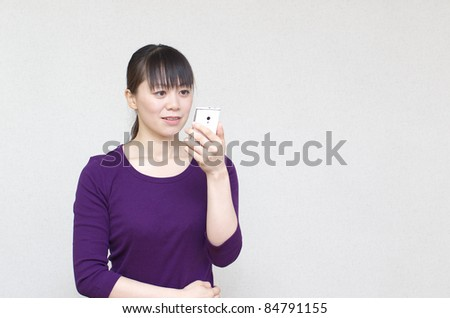 Young woman using a smart phone - stock photo
