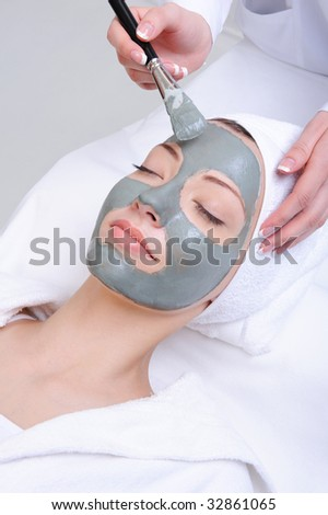 young woman using cosmetic procedure in the beauty salon - stock photo