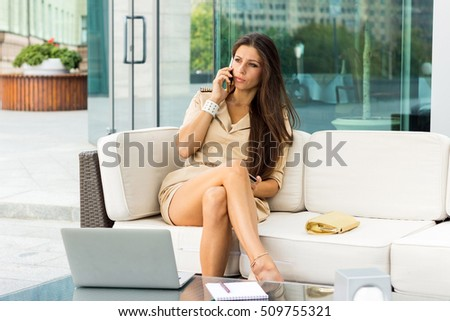 Young woman using credit card in the cafe