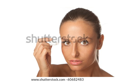 young woman using eye drops on white - stock photo