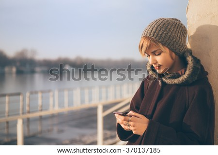 Young woman using her mobile phone - stock photo