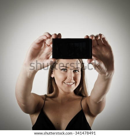 Young woman using her smartphone. - stock photo
