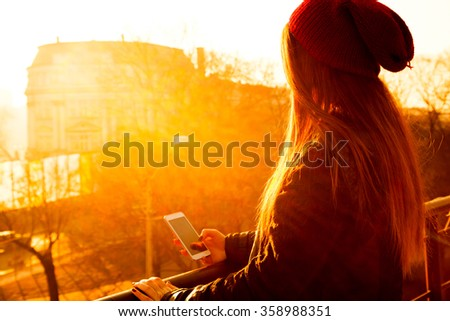 Young woman using her smartphone - stock photo