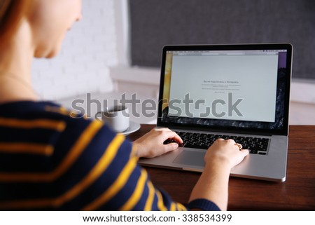 Young woman using his laptop, close up - stock photo