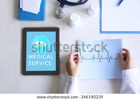 Young woman using his tablet-pc, concept of medical service - stock photo