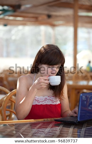 Young  woman using   laptop at resort cafe