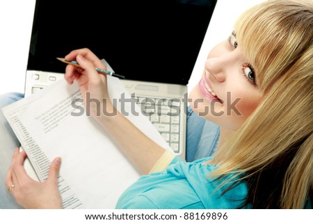 Young woman using laptop isolated on white. Top view.