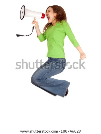 young woman using megaphone and jumping, white background, full lenght