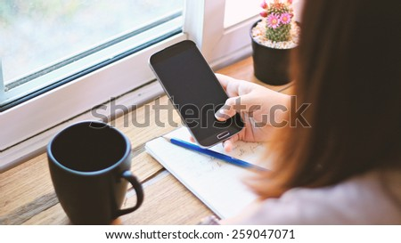Young woman using mobile smart phone. - stock photo