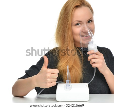 Young woman using nebulizer mask for respiratory inhaler Asthma Treatment isolated on a white background - stock photo