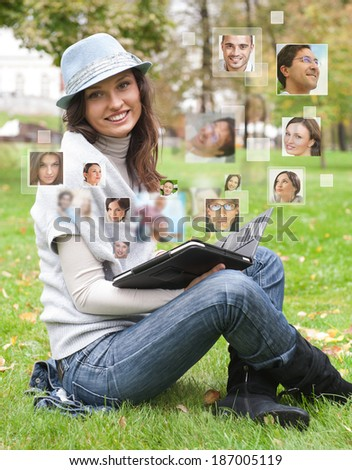 Young woman using tablet computer with many different people's faces around her. Technology social media network of friends and communication. - stock photo