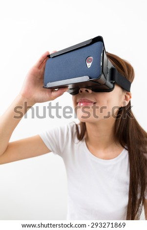 Young woman using virtual reality device - stock photo