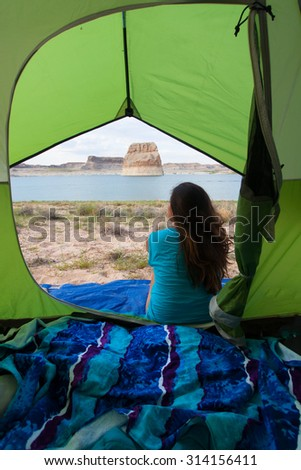 Young woman waking up to a beauitful day at Lake Powell