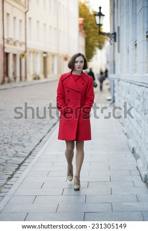Young woman walk by street in old city - stock photo