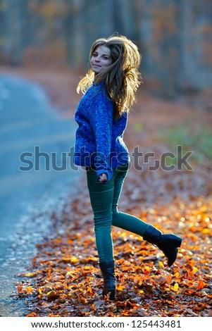 young woman walking - stock photo