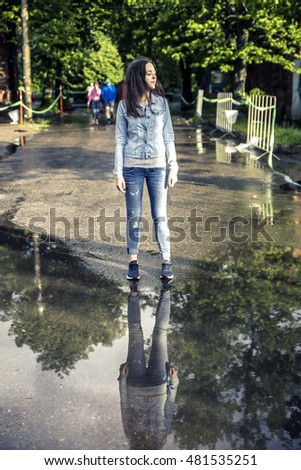 Young woman walking after the rain