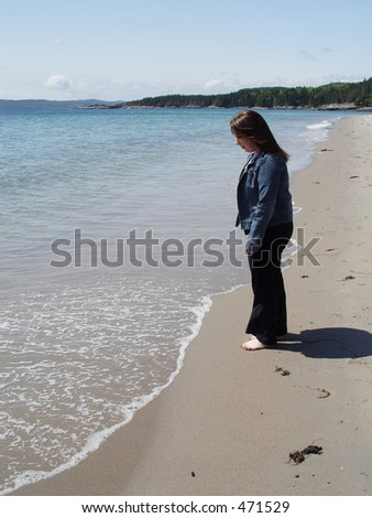 Young woman walking by the ocean