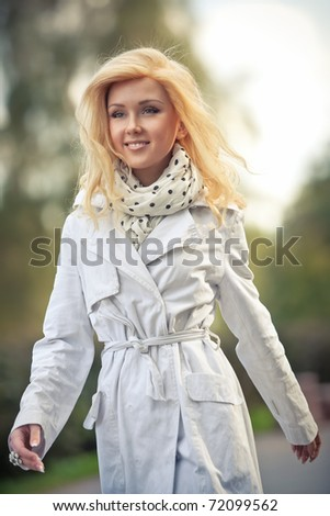 Young woman walking in park. - stock photo