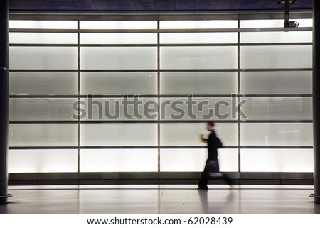 Young woman walking in the train station from Potsdamer Platz, Berlin - stock photo