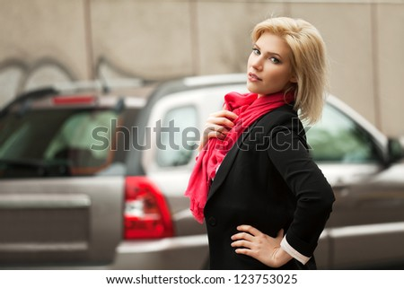Young woman walking on the city street - stock photo
