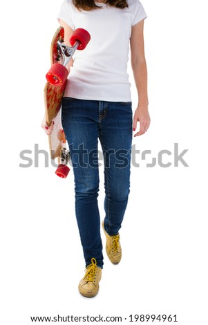Young woman walking with skateboard isolated on a white background. - stock photo