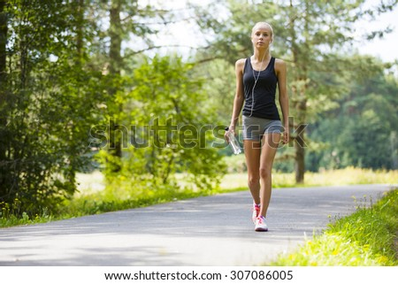 Young woman walks outdoor as workout - stock photo