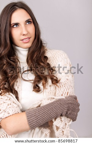 young woman warped wool  scarf on gray background - stock photo