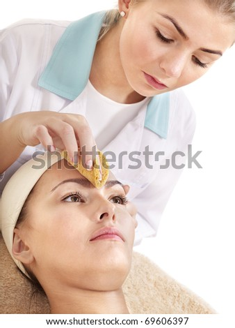 Young woman washing  face by sponge. - stock photo