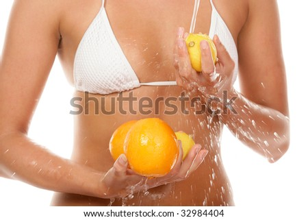 Young woman washing fruits - stock photo