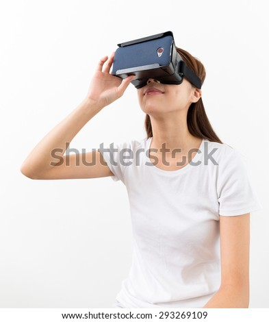 Young woman watch with VR device - stock photo
