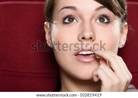 Young woman watching a movie at the cinema - stock photo