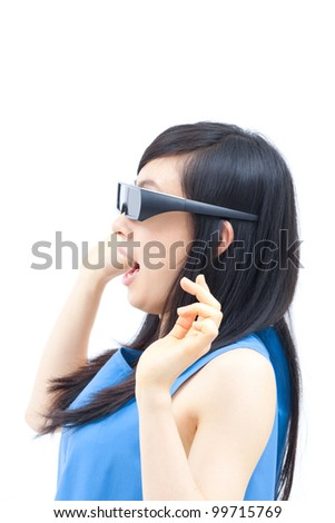 young woman watching TV with 3D glasses