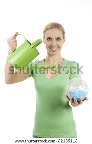 Young woman watering the Earth; concept: lack of water, giving life, saving