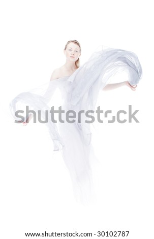 Young woman waving by light fabric over white high key