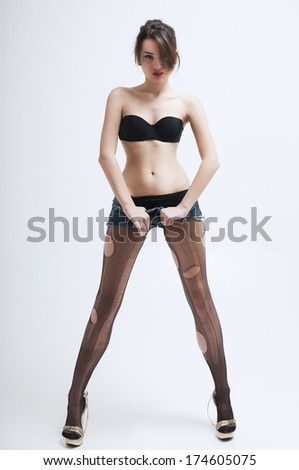 Young woman wear at provocative torn stocking       - stock photo