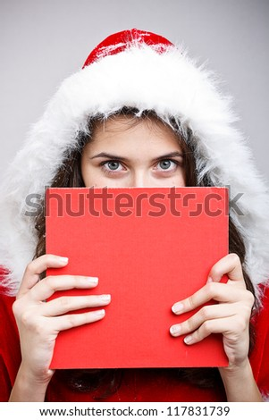 Young woman wear Santa Clause costume hold blank board - stock photo