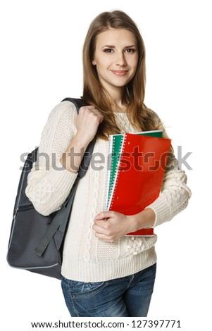 Young woman wearing a backpack and holding notebooks ready to go to class, over white background - stock photo