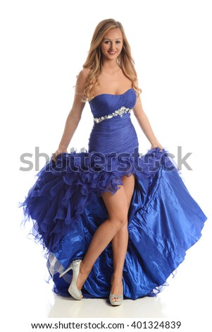 Young woman wearing a blue gown isolated on a white background - stock photo