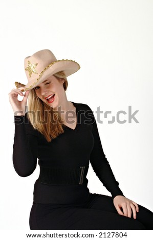 Young woman wearing a cowboy hat and winking. - stock photo