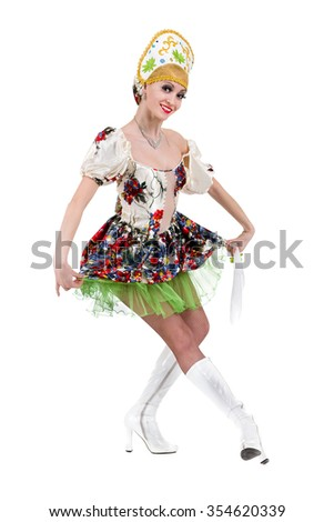 Young woman wearing a folk costumes dancing.  Isolated on white background in full length with copyspace