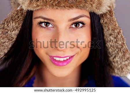 Young woman wearing a fur hat