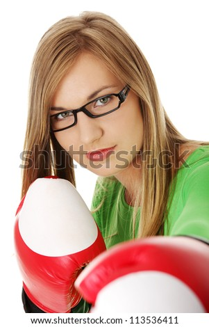 Young woman wearing a pair of boxing gloves. Student woman ready for exams - stock photo