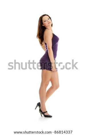 Young woman wearing a purple dress posing isolated on a white background - stock photo